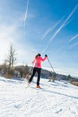 picture of nordic skiing  - Woman cross country skiing - JPG