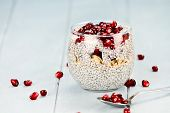 stock photo of pomegranate  - Chia seed parfait made with pomegranate oats and almonds with extreme shallow depth of field - JPG