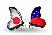 stock photo of samoa  - Two butterflies with flags on wings as symbol of relations Japan and Samoa - JPG