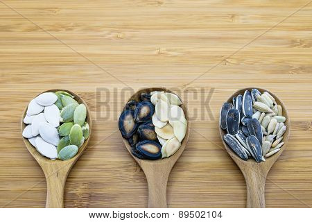 Variety Of Edible Seeds In Wood Spoon On Wood Background