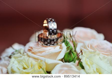 Wedding Rings On Roses Wedding Bouquet