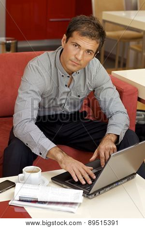 Portrait of young man using laptop