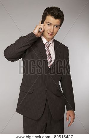 Young caucasian businessman talking on telephone