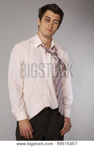 Young beaten up caucasian businessman