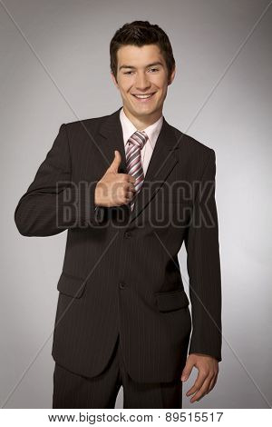 Young caucasian businessman showing ok gesture