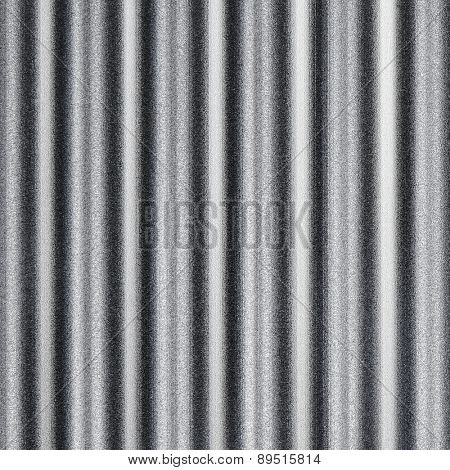 wavy pattern or corrugated chrome metal sheet background.