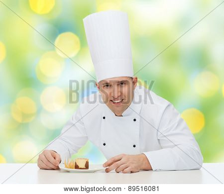 cooking, profession, haute cuisine, food and people concept - happy male chef cook decorating dessert over green lights background