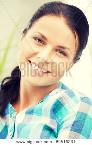 bright closeup picture of smiling woman at home