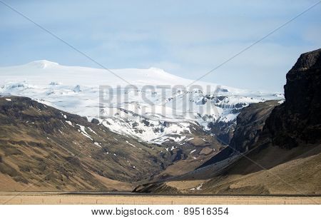 View of snow covered mountains, hills and plains in southern Iceland during winter.