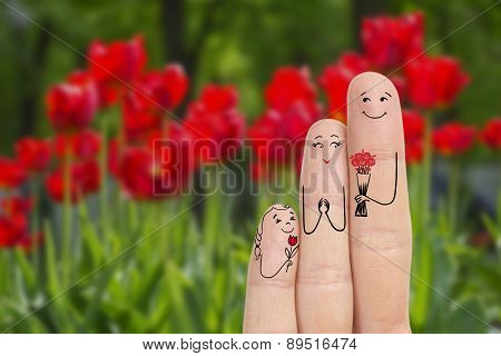 Conceptual Family Finger Art. Father And Daughter Are Giving Flowers His Mother. Stock Image