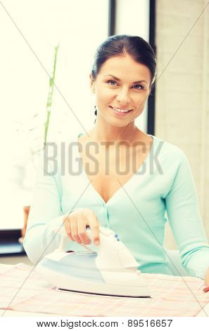 bright picture of lovely housewife with iron