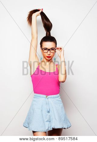 Young glamour girl holding candy and pulls his hair