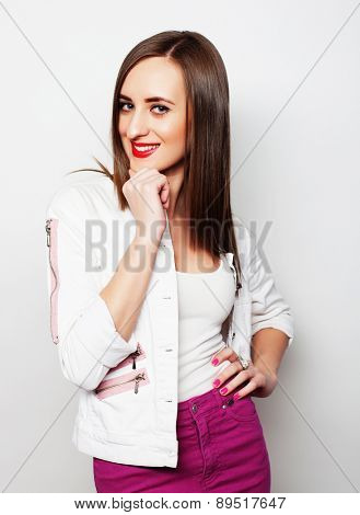 Young glamour woman posing over white background