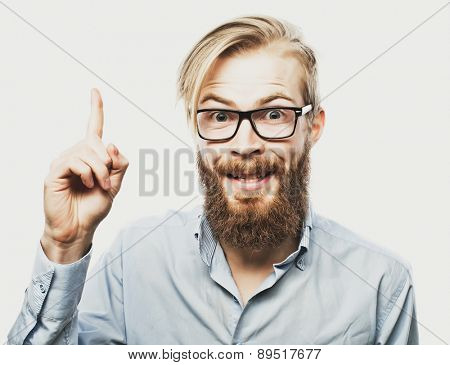 emotional and people concept: young bearded man with good idea sign. Hipster style.