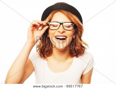 Beautiful young  woman wearing eyeglasses and black hat
