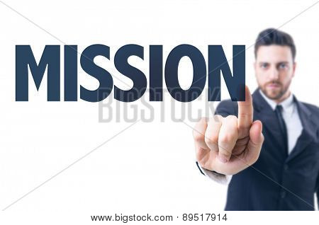 Business man pointing the text: Mission