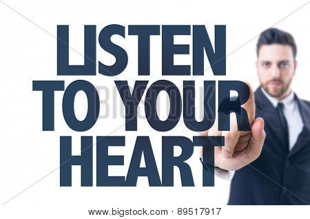 Business man pointing the text: Listen To Your Heart