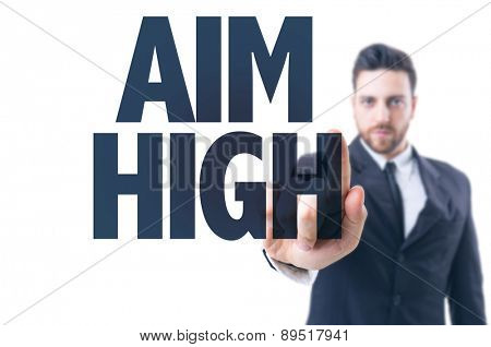 Business man pointing the text: Aim High