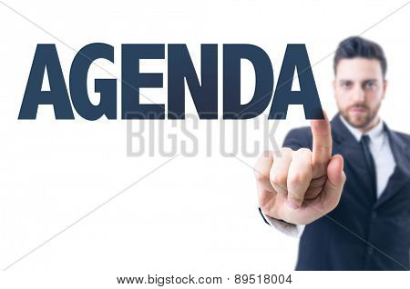 Business man pointing the text: Agenda