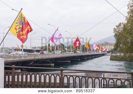 Bridge With Flags In The Centre Of Geneva, Switzerland