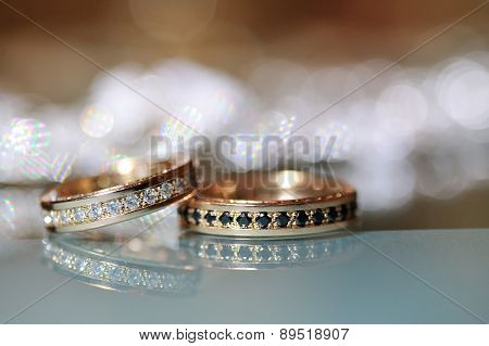 Gold Wedding Rings Laying On The Table