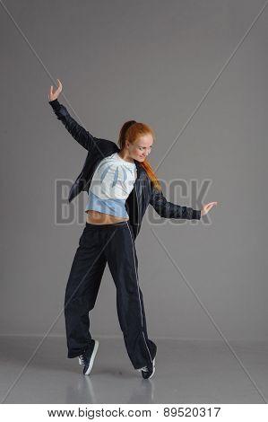 Studio shot of young dancing woman