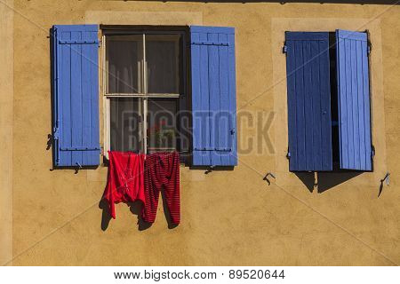 Two Windows With Blue Shutters. France.languedoc. Camargue.