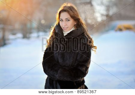 Beautiful Girl In Brown Winter Coat On The Street