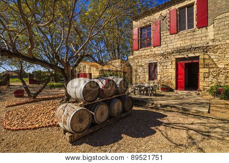 Wine Barrels In The Background Of An Ancient House. France. Languedoc, Camargue.