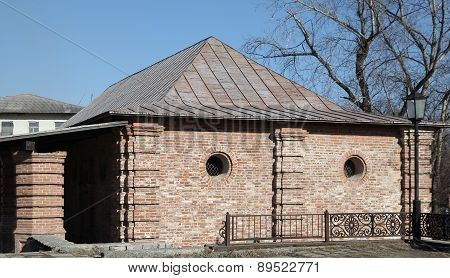 Old Brick House With Small Round Windows