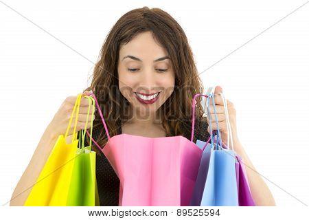 Surprised Woman Looking To Her Gift In A Paper Bag