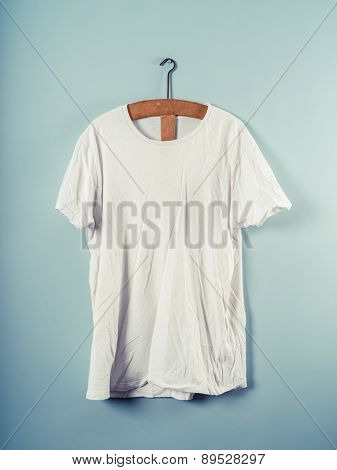 White T-shirt And Wooden Hanger