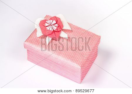 pink gift box with origami paper heart.