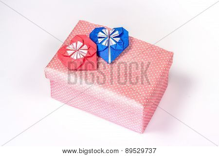 valentines gift box with red and blue paper hearts