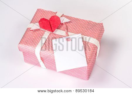 pink gift box with origami paper heart and blank card