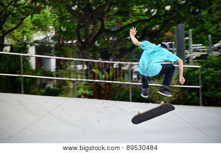 Bangkok, Thailand - April 10, 2015: Skater Jumps High In Air