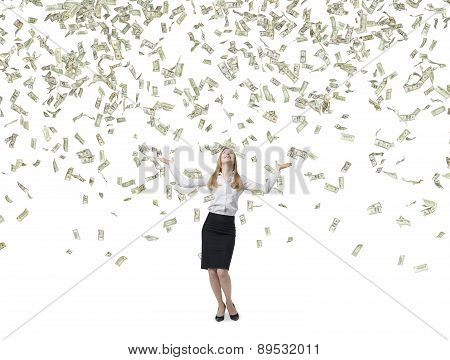 Beautiful Blonde Business Woman Is Happy About Flying Dollars Notes. Isolated On White Background.