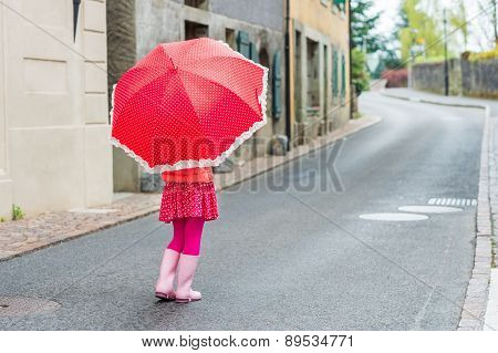 Cute little girl walking down the street