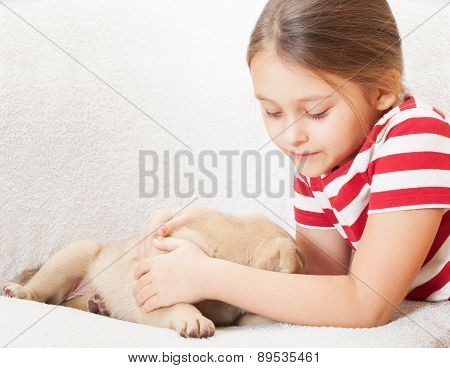 Girl Tenderly Embraces A Pet