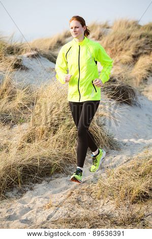 Active Woman Running On A Beach