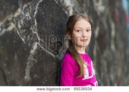 Outdoor portrait of a pretty little girl of 7 years old