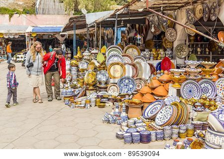 SAFI,  MOROCCO, APRIL 6, 2015: Tourists visit the pottery souk in Safi, capital of ceramics craft