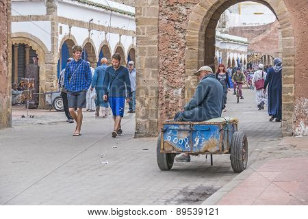 AS-SAWIRA, MOROCCO, APRIL 7, 2015: Local man wait with his hand pushed cart serving to transport tourists' baggage inside medina, where car traffic is forbidden