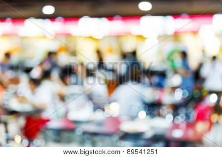 Blurred People In Food Center