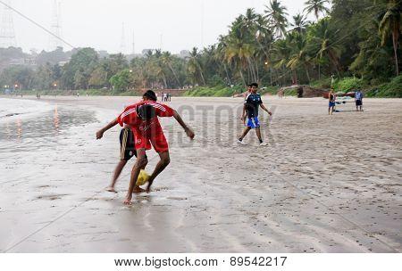 Men Playing Football (soccer) On Goa Beach