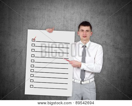 Man Holding Placard With Check Box