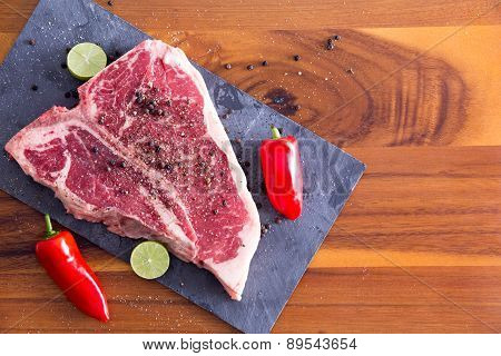 Steak On Cutting Board With Lime And Pepper