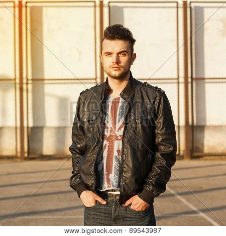 Spring Portrait Of A Young Guy In A Leather Jacket On A Sunny Day.