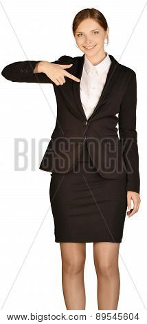 Young girl dressed suit presses forefinger in the empty space