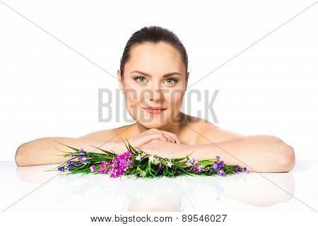 Portrait Of Beautiful Woman In Spring Flowers